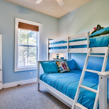 Bunkroom features full-sized bed, full-size pullout trundle, and twin upper bed